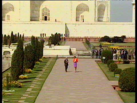 zoom out from princess diana walking with official in front of taj mahal during official visit india 11 feb 92 - taj mahal stock videos and b-roll footage