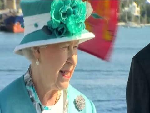 stockvideo's en b-roll-footage met zoom out from queen elizabeth ii and prince philip onboard ship during trip to bermuda 26 november 2009 - atlantische eilanden