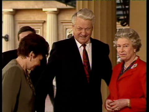 zoom out from queen elizabeth ii russian president boris yeltsin and wife naya posing for photos outside buckingham palace next to duke of edinburgh... - 1992 stock videos & royalty-free footage