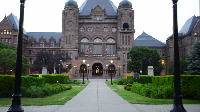 zoom out from queen's park building, toronto, canada - canada politics stock videos & royalty-free footage