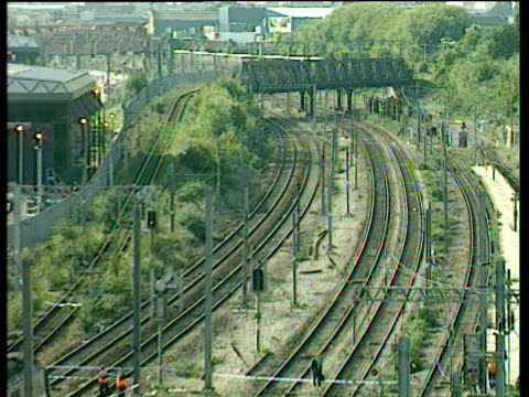 zoom out from railway tracks to crash wreckage paddington train crash 05 oct 99 - train crash stock videos and b-roll footage