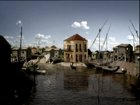 zoom out from reconstruction of boatyard during merchant venice period - market trader stock videos & royalty-free footage