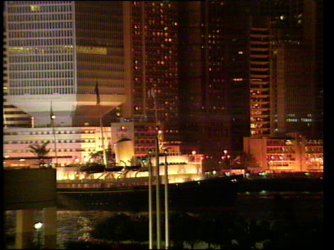 zoom out from royal yacht britannia leaving harbour hong kong skyline in background hong kong handover 30 jun 97 - editorial stock videos & royalty-free footage