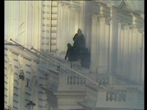 zoom out from sas entering iranian embassy to end siege london 05 may 80 - belagerung stock-videos und b-roll-filmmaterial