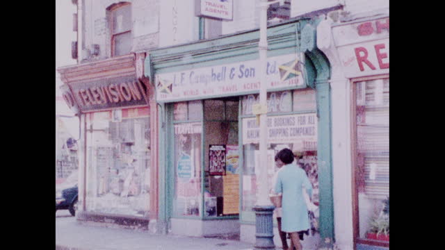 zoom out from sign above travel agency in brixton; 1973 - capital letter stock videos & royalty-free footage
