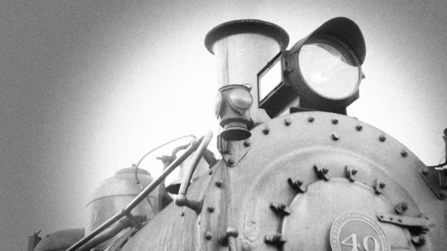 Zoom Out from Steam Engine Train Smoke Stack - BW