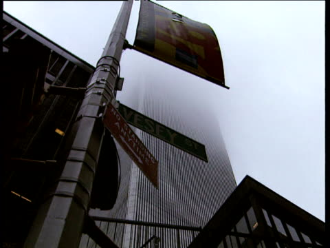 zoom out from street signs with world trade centre in background new york - 1993 stock-videos und b-roll-filmmaterial