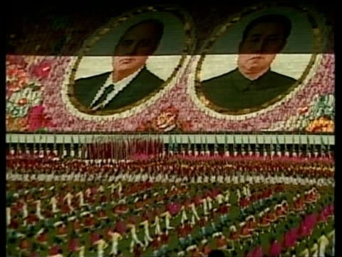 Zoom out from synchronised display featuring faces of leaders Mikhail Gorbachev and Kim Il Sung in celebration of Soviet Korean friendship North...