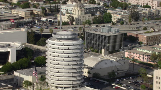Zoom out from the Capitol Records Tower to a scenic Hollywood landscape.