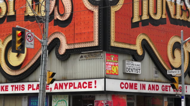 stockvideo's en b-roll-footage met zoom out from the corner of the store sign towards the general atmosphere in bloor street honest ed's was a landmark discount store named after its... - sociale geschiedenis