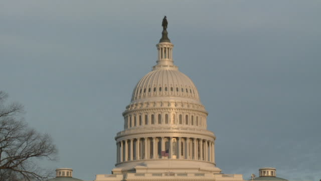 zoom out from the dome of the u.s. capitol building to reveal a wide shot of the building and the reflecting pool. u.s. capitol building zoom out on... - united states congress stock videos & royalty-free footage