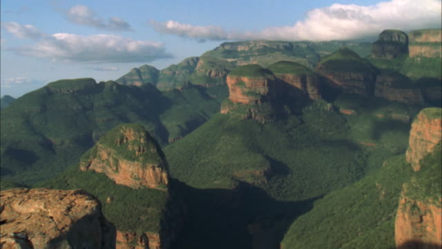 zoom out from three rondavels rock formation to woman sitting looking out over blyde river canyon, mpumalanga, south africa available in hd. - blyde river canyon stock videos and b-roll footage