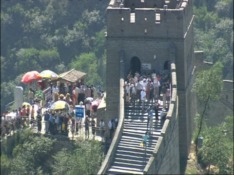 zoom out from tourists milling around tower on great wall of china, high angle, badaling, china - badaling stock videos & royalty-free footage