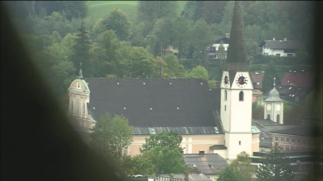 zoom out from tower of parish church to bell swinging in bell tower of pilgrimage church (kalvarienberg kirche), bad ischl, austria - kirche stock videos and b-roll footage