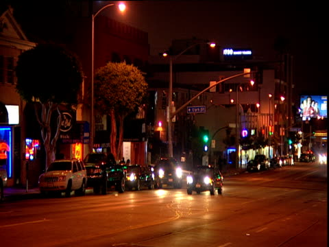 Zoom out from traffic on Sunset Strip at night Los Angeles