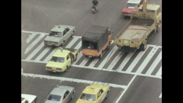 zoom out from traffic on tokyo street; 1972 - showa period stock videos & royalty-free footage