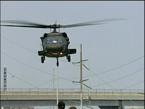 zoom out from us army helicopter taking off from freeway during evacuation from new orleans following hurricane katrina; 4 sep 05 - hurricane katrina stock videos and b-roll footage