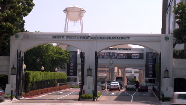 zoom out from water tower to studio gate at sony pictures movie studio at overland boulevard - culver city stock videos & royalty-free footage