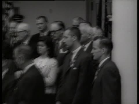 b/w zoom out gemini astronauts to charles matthews getting award / ed white jim mcdivitt 1960's / sound - ed white astronaut bildbanksvideor och videomaterial från bakom kulisserna