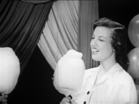 B W 1949 Zoom Out Pan Girl Wearing Dress Boy Wearing Suit Eating Cotton
