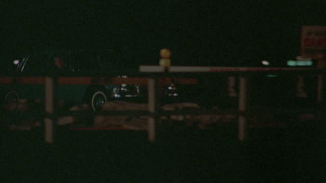 pan zoom out mercedes driving off end of pier at night into water / pretty maids all in a row (1971) - mercedes benz stock videos and b-roll footage