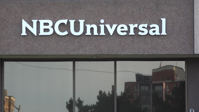 zoom out nbc universal or nbcuniversal studios building exterior nbcuniversal is an american multinational media conglomerate - nbc stock videos & royalty-free footage
