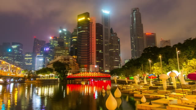 zoom out night to day timelapse of singapore cityscape - river singapore stock videos & royalty-free footage