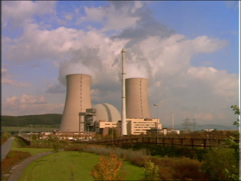zoom out nuclear power plant in countryside - nuclear energy stock videos & royalty-free footage