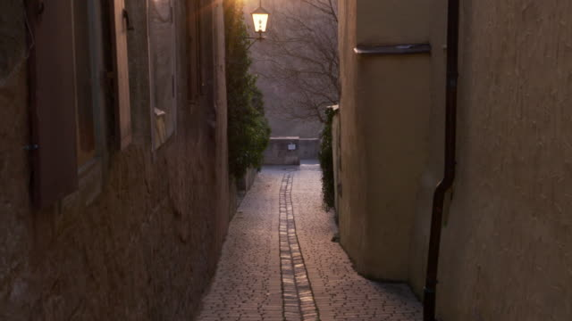 zoom out of a small footpath with sun at backlight. - rothenburg stock videos and b-roll footage