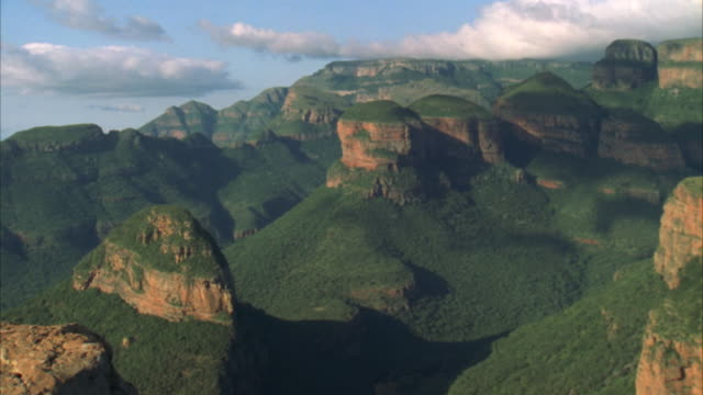 zoom out of a woman sitting atop a mountain looking out towards blyde river canyon - blyde river canyon stock videos and b-roll footage