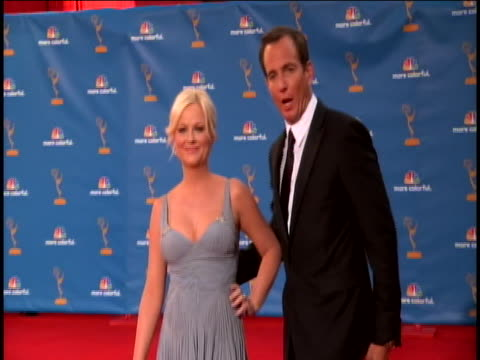 zoom out of amy poehler as she joins husband will arnett on the red carpet at the 62nd primetime emmy awards. poehler was nominated for outstanding... - ウィル アーネット点の映像素材/bロール