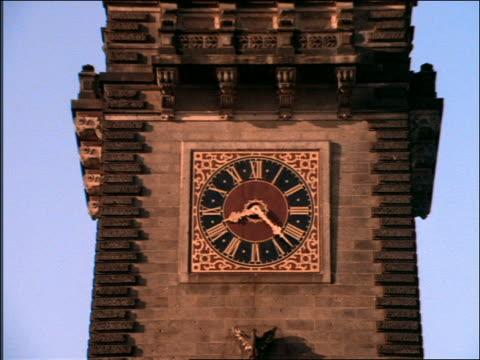 zoom out of clock tower on rathaus (city hall) / hamburg - rathaus hamburg stock-videos und b-roll-filmmaterial