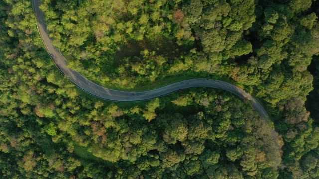 zoom out of curve road on mountain peak - mountain pass stock videos & royalty-free footage