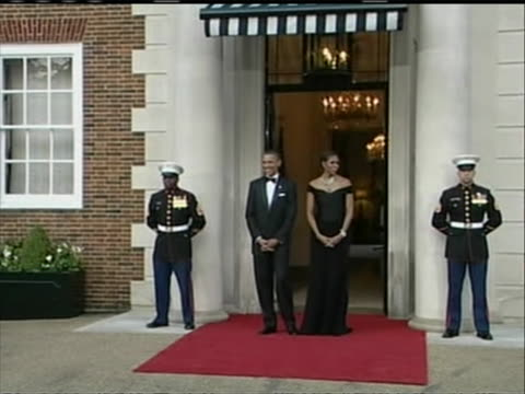 zoom out of president barack obama and first lady michelle obama standing in the entrance of winfield house where the president is holding a dinner... - (war or terrorism or election or government or illness or news event or speech or politics or politician or conflict or military or extreme weather or business or economy) and not usa stock videos & royalty-free footage