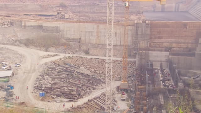 zoom out of the partially constructed grand ethiopian renaissance dam in ethiopia - ethiopia stock videos & royalty-free footage