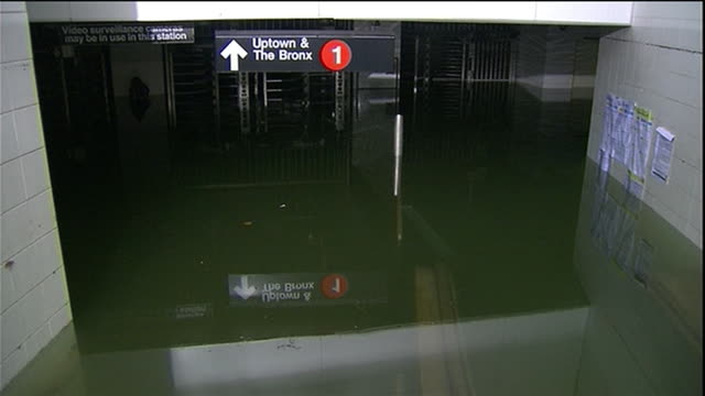 zoom out of water to submerged turnstiles and sign for 1 train in new york city subway - environment or natural disaster or climate change or earthquake or hurricane or extreme weather or oil spill or volcano or tornado or flooding stock videos & royalty-free footage