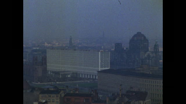 zoom out old cathedral to modern building in east berlin; 1989 - establishing shot stock videos & royalty-free footage