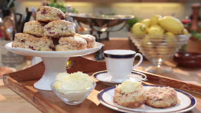 zoom out on scones and tea. - afternoon tea stock videos & royalty-free footage
