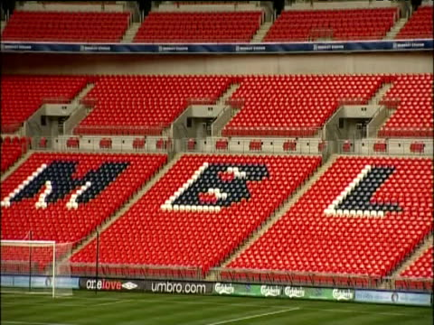 zoom out over pitch and rows of seats inside wembley stadium london - wembley stadium stock videos & royalty-free footage