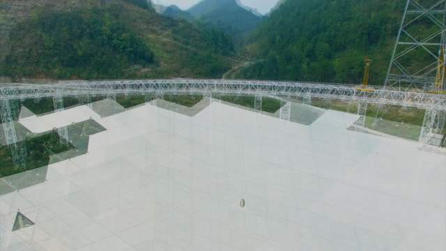 Zoom out over the Five hundred meter Aperture Spherical Telescope in Guizhou Province China