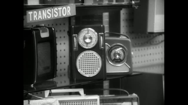 zoom out past electronic shop window with radios; 1963 - radio stock videos & royalty-free footage