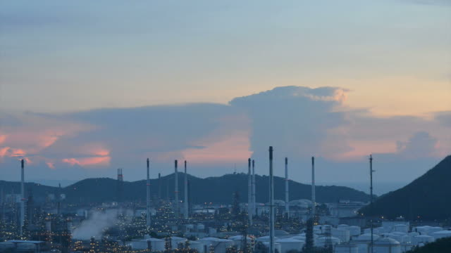 Zoom out: Petrochemical industry - Oil refinery at twilight