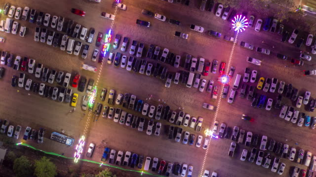 zoom out rotate time lapse of parking lot in celebration event festival with colourful lighting - zoom out stock videos & royalty-free footage