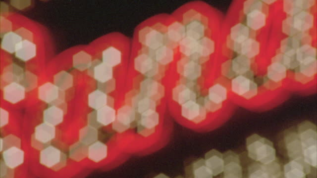 stockvideo's en b-roll-footage met zoom out shot of a flashing neon signboard of sands in las vegas. - casino