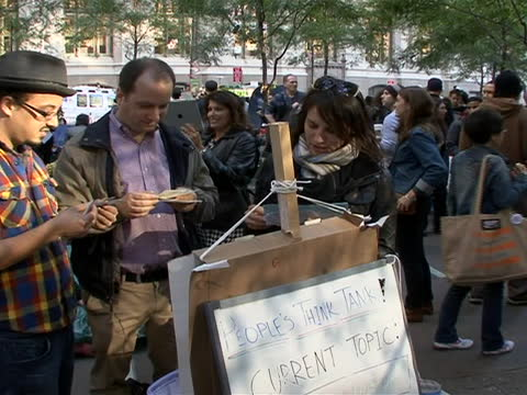 zoom out shot of a think tank at the 'occupy wall street' site in lower manhattan. this station reflects the ethos of equality that drove the... - brainstorming stock videos & royalty-free footage