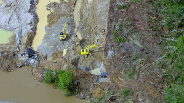 zoom out shot of backhoes digging at illegal gold mine, colombia - medellin colombia stock videos & royalty-free footage