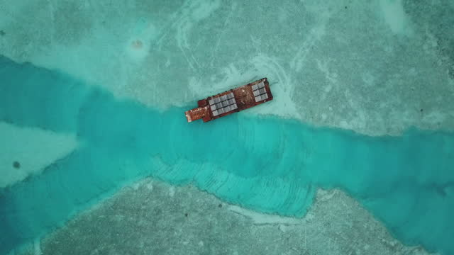 zoom out shot of barge floating on sea - floating moored platform stock videos & royalty-free footage