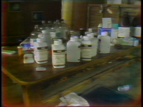 zoom- out shot of bottles of potassium cyanide that were found after the mass suicide of over 900 cult members, including over 200 children in... - potassium stock videos & royalty-free footage