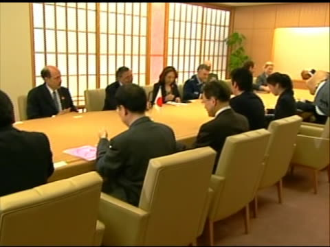 zoom out shot of leon panetta sitting at a conference table with japanese minister of foreign affairs koichiro gemba. this meeting took place in... - united states and (politics or government)点の映像素材/bロール