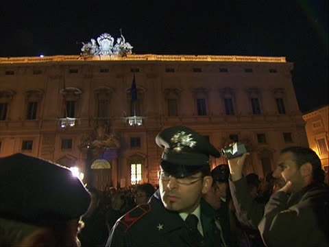 zoom out shot of police facing off with citizens celebrating the resignation of prime minister silvio berlusconi he stepped down after failing to... - business or economy or employment and labor or financial market or finance or agriculture video stock e b–roll